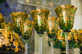 Luxury green golden goblets in white and color closeup photo with lots of copy space Stock Photo