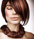 Luxury hairstyle closeup portrait of attractive woman with shiny fringe and stylish braid closed eyes modeling and styling concept Royalty Free Stock Photography