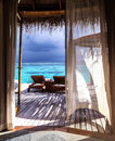 Luxury honeymoon romantic place for beautiful wooden bungalow on the water two deckchair on the terrace vacation on maldives Stock Photography