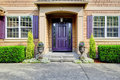 Luxury house exterior. Entrance porch with purple door Royalty Free Stock Photo
