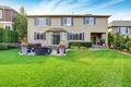 Luxury house exterior with impressive backyard landscape design Royalty Free Stock Photo