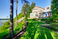 Luxury house exterior with impressive backyard landscape design. Royalty Free Stock Photo