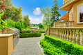 Luxury house exterior walkway with beautiful curb appeal view of and trimmed hedges and barbecue Stock Photography