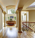 Luxury house interior hallway beautiful with columns view of living room and wrought railings Royalty Free Stock Images