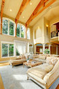 Luxury house interior living room impressive with high ceiling antique furniture columns and balcony Stock Image