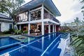Luxury java villa exterior in with a garden and swimming pool Royalty Free Stock Photos