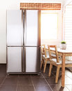 Luxury kitchen interior steel refrigerator on the bright sun light from the windows beautiful apartment stylish fridge wealth Stock Images