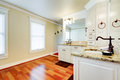Luxury large white master bathroom with cherry hardwood. Royalty Free Stock Photo