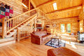 Luxury log cabin living room with leather sofa. Royalty Free Stock Photo