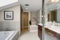 Luxury master bathroom with white tile floor. Royalty Free Stock Photo