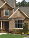 Luxury Model Home Exterior front door bay window Royalty Free Stock Photo