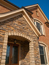 Luxury Model Home Exterior stone arch entrance Royalty Free Stock Photo