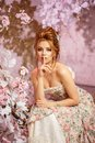 Luxury model in vintage style. Beautiful woman with a stunning hairstyle and make-up in a rococo dress. Girl at the Masquerade