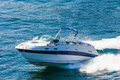 Luxury motorboat fast going on calm sea Stock Photos