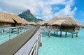 Luxury overwater vacation resort on bora bora bungalows in a in the clear blue lagoon with a view the tropical island of near Stock Images