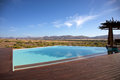 Luxury pool in a hotel and the desert of Namibia Royalty Free Stock Photo