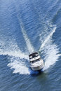 Luxury power boat yacht on blue sea aerial photograph of speedboat Stock Photos