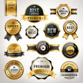 Luxury premium quality golden labels collection over pearl white background Royalty Free Stock Photos