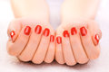 Luxury red manicure on the white towel closeup Stock Photo