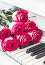 Luxury red roses on a piano. Bouquet of red roses and piano Royalty Free Stock Photo