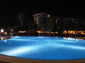 Luxury resort with beautiful pool and illumination night view scene Stock Image