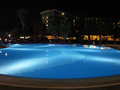Luxury resort with beautiful pool and illumination night view scene Royalty Free Stock Photography
