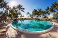 Luxury resort pool with palms and blue sky Stock Photo