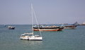 Luxury sailing boat, fishing and cargo ships at anchor in the port of Djibouti Royalty Free Stock Photo