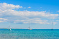 Luxury sailing catamaran and two sailing boats in open sea Royalty Free Stock Photo