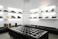 Luxury shoe store with bright interior large new collection Stock Photography