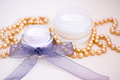 Luxury spa products and gold beaded necklace Stock Photo