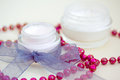 Luxury spa products and red beaded necklace Stock Photography