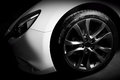 Luxury sports car close up of aluminium rim and headlight Royalty Free Stock Photo