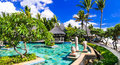 Tropical holidays - swim pool area and bar near the beach. Mauri Royalty Free Stock Photo