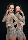 Luxury two sexy glamorous women in shiny dresses couple females silver posing Royalty Free Stock Images