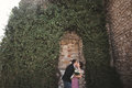 Luxury wedding couple hugging and kissing on the background gorgeous plants, cave near ancient castle Royalty Free Stock Photo
