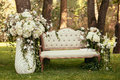 luxury wedding decorations with bench, candle and flowers compisition on ceremony place Royalty Free Stock Photo