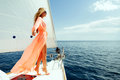 Luxury woman pareo yachting in sea with blue sky sunlight Royalty Free Stock Photo
