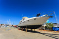 Luxury yacht beached for annual service and repair Stock Image