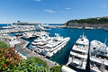 Luxury yacht monte carlo monaco jun view on port hercules with luxery yachts and a cruiseship on june in monte carlo it is the Royalty Free Stock Image