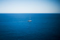 Luxury yacht sailing on the sea in tropical calm tilt shift lens used to accent boat and to emphasize attention it in Royalty Free Stock Photography