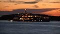 Luxury yacht silhouette at dusk illuminated on sea Stock Photo