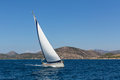 Luxury yacht with white sails in the Aegean sea Royalty Free Stock Photo