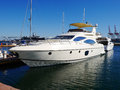A luxury yacht at the yacht club in port Royalty Free Stock Photography