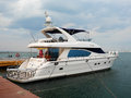 A luxury yacht at the yacht club in port Royalty Free Stock Photo
