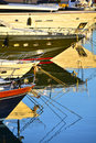 Luxury yachts bows view of and reflections in water Royalty Free Stock Photography