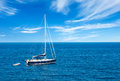 Luxury yatch in open waters with beautiful clouds Royalty Free Stock Image