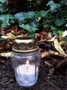 Luz de una vela en la tierra Foto de archivo libre de regalías