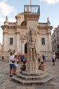 Luza square dubrovnik croatia july tourists walk along on with statue of roland ital orlando symbol of freedom and church of st Stock Images