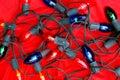 Luzes do feriado no veludo Imagens de Stock Royalty Free